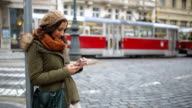 Young woman text messaging in Prague