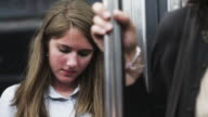 CU TU TD Young woman texting in subway train / Paris, France