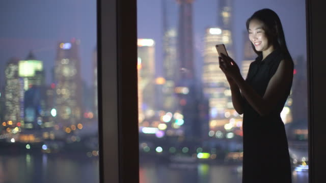 WS young woman texting on a phone at night.