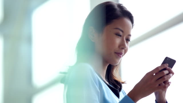 CU young woman texting on a smart phone.