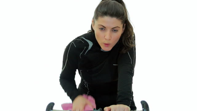 Young woman tired working out on bicycle.