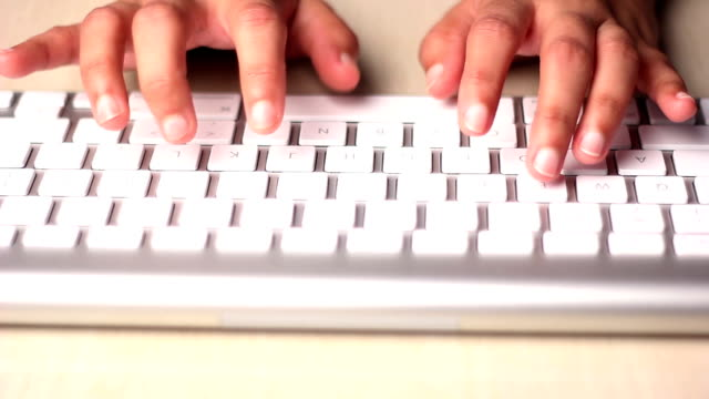 Young Woman typing on the keyboard