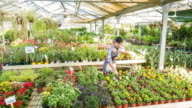 Young woman using digital tablet in garden center