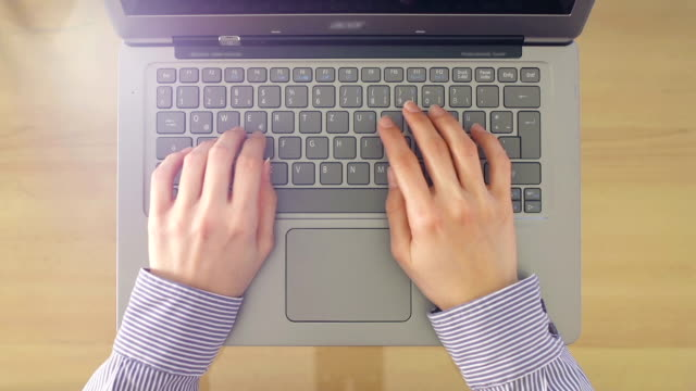 Young woman using laptop - typing