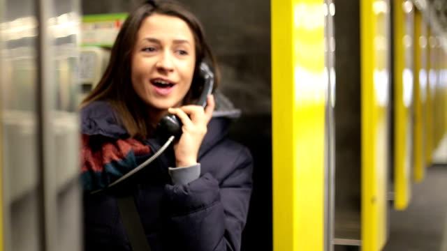 Young woman using Subway phone