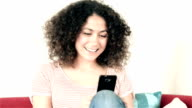 DOLLY: Young woman video chatting at home