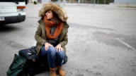 Young woman waiting for transportation in winter