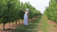 HD Young woman walking at garden