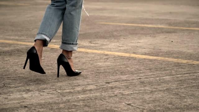 Young woman walking high heel
