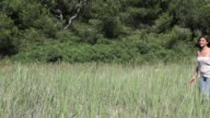Young woman walking in field
