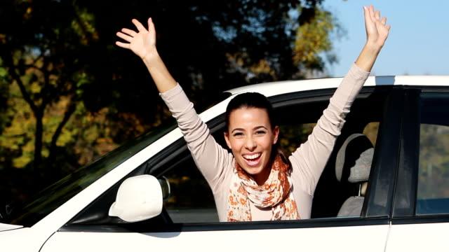 Young woman waving