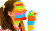Young woman with artistic makeup in rainbow colors