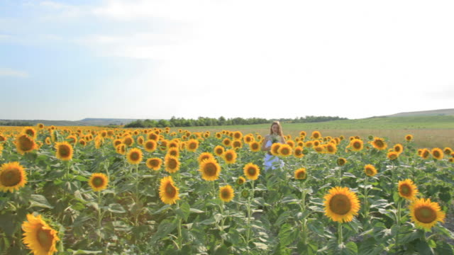 HD Young woman with sunflower oil jug