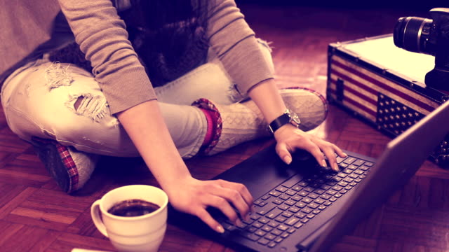 Young Woman Working At Home CNGLBUS876