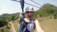 POV young woman ziplining in Belize