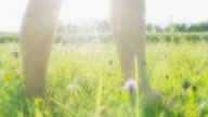 HD: Young Woman's Feet In Grass