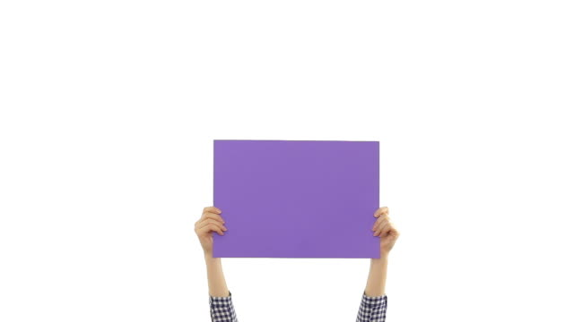 Young woman's hands holding a blank purple placard.