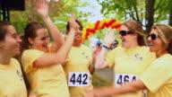 CU ZI Young women and teenage girls celebrating after charity fun run / Salem, Massachusetts, USA