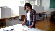 Young women architect examine an new architectural project