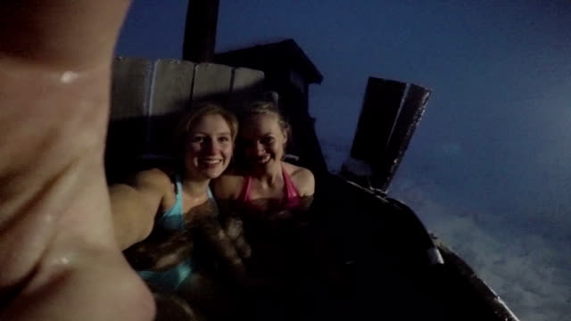 Young women in hot tub on ski holiday