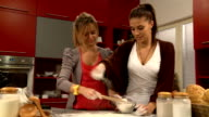 Young women in the kitchen (HD)