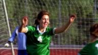 SLO MO, MS, ZI, CU, FOCUSING, Young women playing soccer, scoring goal and cheering, Biola University, La Mirada, California, USA