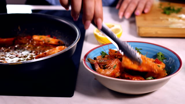 Young Women Preparing Shrimps at Home