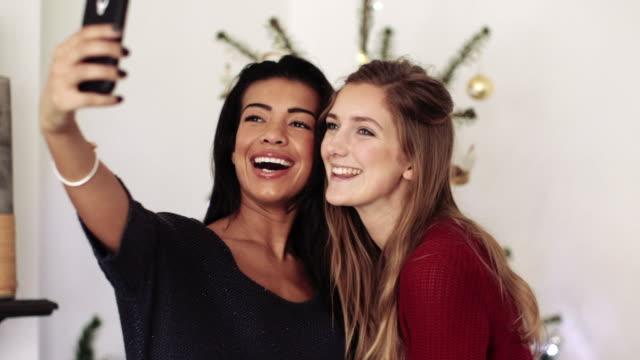 Young women taking self photograph