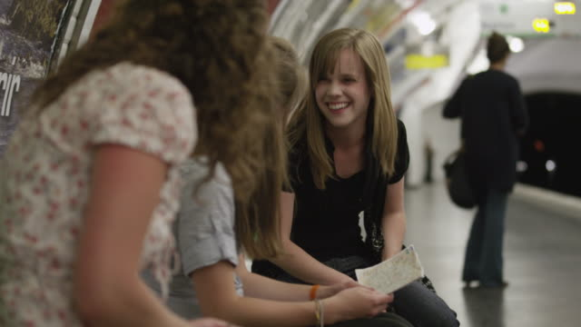 MS Young women talking in metro station / Paris, France