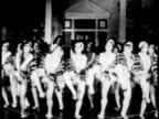HARLEM Young women tap dancing on dance floor w/ band BG TU Neon 'Cotton Club' sign WS women dancing low stage MS Edward Kennedy 'Duke' Ellington...