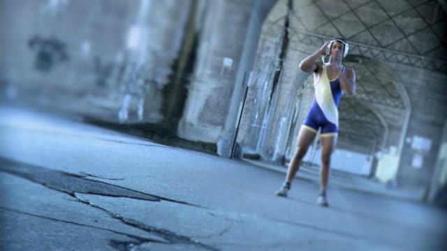 Young Wrestler Standing in a Grunge Setting - Version 2
