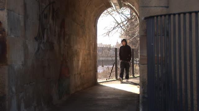 Youth / Hoody walking in tunnel - HD & PAL