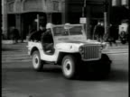 Yugoslavia Pres Josip Tito smoking LA WS Mounted Military Police in parade Berlin Germany MS MPs driving jeep HA WS Golden Gate Bridge San Francisco...