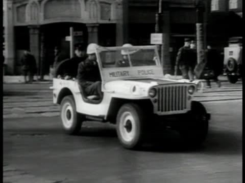 Yugoslavia Pres Josip Tito smoking LA WS Mounted Military Police in parade Berlin Germany MS MPs driving jeep HA WS Golden Gate Bridge San Francisco...
