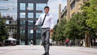 SLO MO Yuppie skateboarding in the city