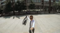 Yuppie taking a selfie at business district