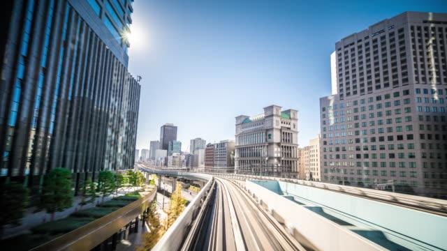 T/L WS POV Yurikamome Train Riding Through Downtown Tokyo / Tokyo, Japan