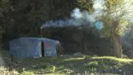WS Yurt with smoke coming from chimney / Tian Chi, Xinjiang, China