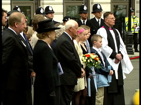 memorial service ITN ENGLAND London Libyan Embassy Metropolitan police chief Sir John Stevens along past embassy with PC Yvonne Fletcher's parents to...
