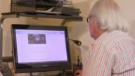 Yvonne Fletcher murder inquiry collapses London John Murray looking at story on internet Close shot screen Murray John Murray interview SOT