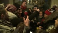 Zac Efron poses with fans as he tries to leave the Today show in Rockefeller Center in Celebrity Sightings in New York