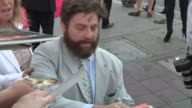 Zach Galifianakis greets fans while departing The Hangover III Premiere in Westwood 05/20/13