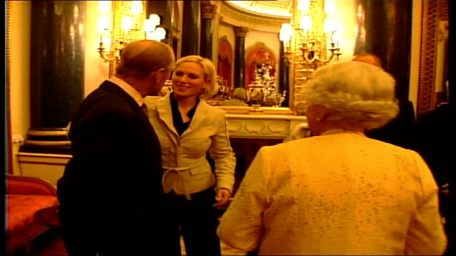 Zara Phillips' ambitions for Beijing Olympics LIB ENGLAND London Buckingham Palace INT Queen Elizabeth II and Prince Phillip greeting Zara Phillips...