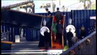 Zara Phillips prewedding reception on royal yacht Britannia SCOTLAND Edinburgh EXT Zara Phillips and her fiance Mike Tindall up steps to former Royal...