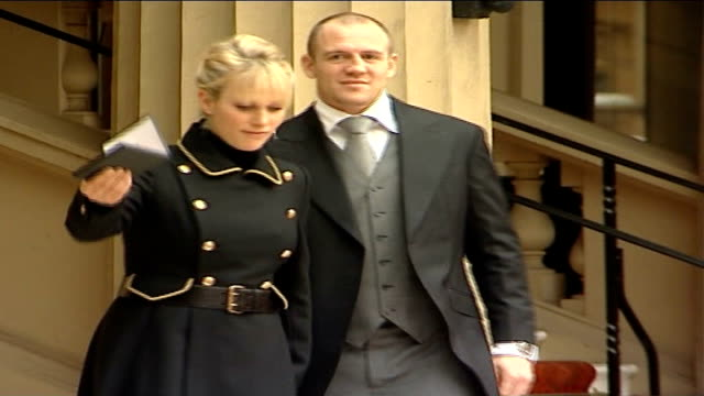 Zara Phillips receives MBE from Queen ENGLAND London Buckingham Palace EXT Reporter to camera Zara Phillips along with her boyfriend Mike Tindall and...