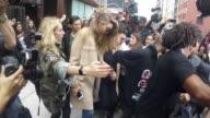 Zayn Malik Gigi Hadid face fans in New York City on March 25 2016 in New York City
