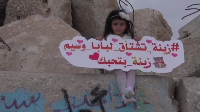Zeina Sarhan marks her fourth birthday without her father who since traveling to Sweden four years ago has been unable to return to his native Gaza...