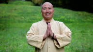 Zen master bowing and smiling portrait