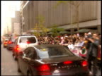 Ziegfeld Theatre marquee to fans behind barricades on street traffic slowly passing by fans screaming block the streets