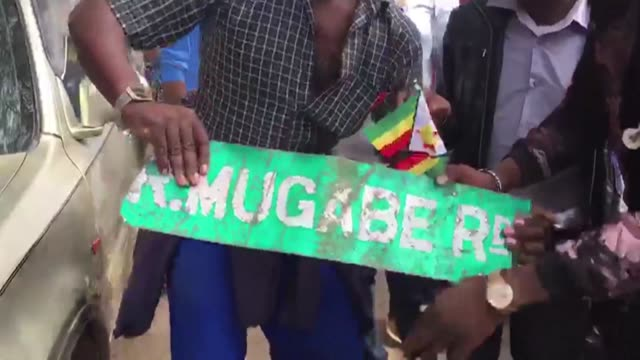 Zimbabwe soldiers blocked thousands of protesters as they tried to march on embattled President Robert Mugabe's official residence in Harare on...